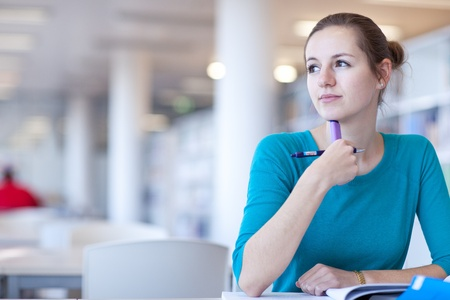 pretty young college student in a library (shallow DOF; color toned image) Stock Photo - 9798956