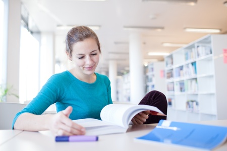 pretty young college student in a library (shallow DOF; color toned image) photo