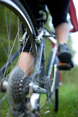 fast foot: biking - rear wheel of a young woman Stock Photo