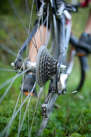 outdoor pursuit: biking - rear wheel of a young woman Stock Photo