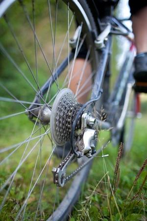 bikercross: biking - rear wheel of a young woman Stock Photo
