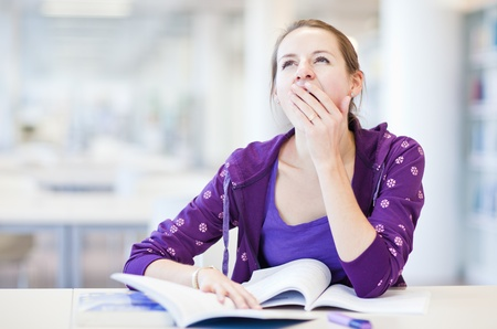 pretty young college student in a library - being tired/exhausted (shallow DOF; color toned image) Stock Photo - 9798276