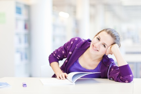pretty young college student in a library (shallow DOF; color toned image) Stock Photo - 9798265