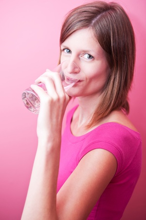 pretty, young woman drinking fresh water from a glass Stock Photo - 9798479