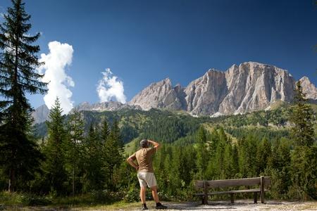 man admiring a breathtaking mountain/alpine scenery (Val di Gardena, Dolomites, Italy) Stock Photo - 9802870