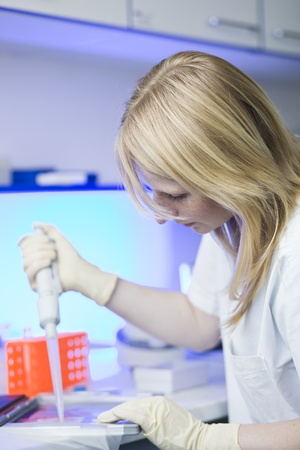 portrait of a female researcher doing research in a lab (color toned image; shallow DOF) photo