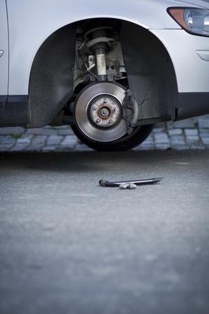 mechanic changing a wheel of a modern car photo