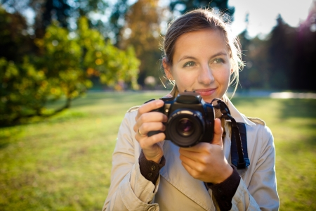 pretty female photographer outdoors on a lovely sunny day Stock Photo - 9816739