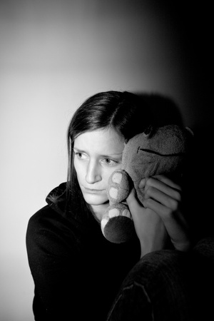 headshrinker: Young woman suffering from a severe depressionanxiety  Stock Photo