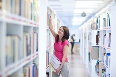 choose university: pretty young college student in an university library (shallow DOF; color toned image)