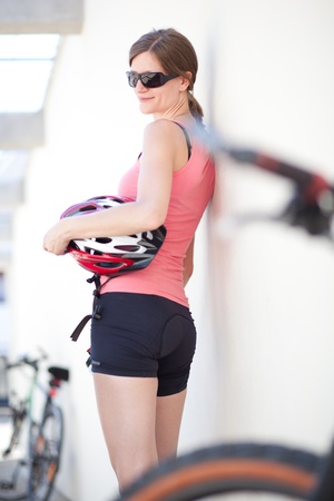 portrait of a pretty female biker photo