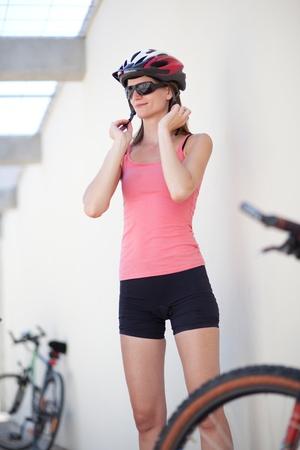 biker girl: portrait of a pretty female biker