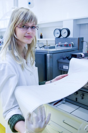 portrait of a female researcher carrying out research in a chemistry lab (color toned image; shallow DOF) Stock Photo - 9816715