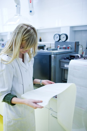 portrait of a female researcher carrying out research in a chemistry lab (color toned image; shallow DOF) Stock Photo - 9812242