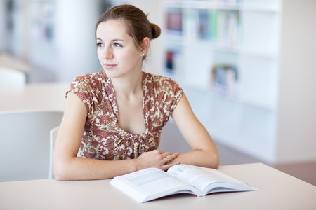 pretty young college student in a library (shallow DOF; color toned image) Stock Photo - 9808076