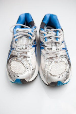 Pair of running shoes on a white background  (shallow DOF; color toned image) photo