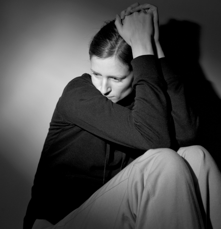 emotional grief: Young woman suffering from severe depression