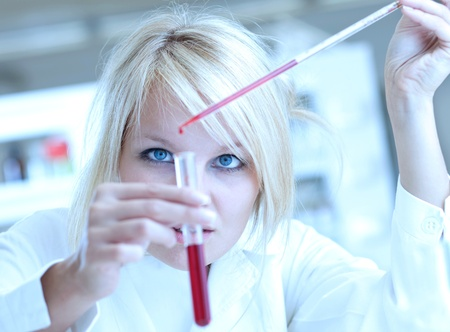 Closeup of a female researcher carrying out experiments in a lab Stock Photo - 9794365