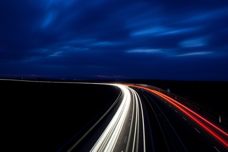 Cars moving fast on a highway photo