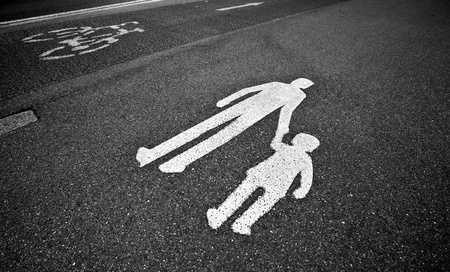 parental guidance concept - pedestrian sign on the  pavementsidewalk photo