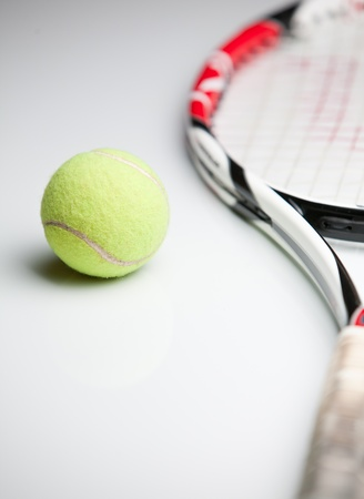 tennis ball and racket photo