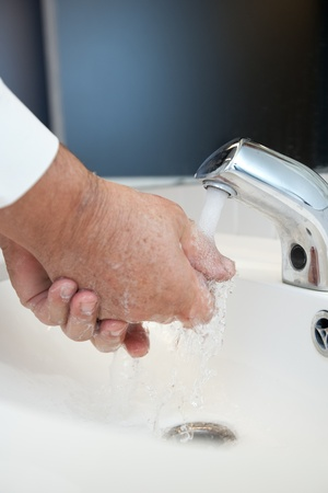 Fludisease prevention - Washing hands thoroughly with running water and soap photo