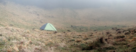 tent on a foggy morning outdoors (panoramic photo made of multiple shots -> great resolution, very suitable for large size prints) photo