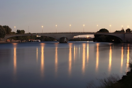 Bridge over a big river - at night with street lamps (Avignon, France) photo