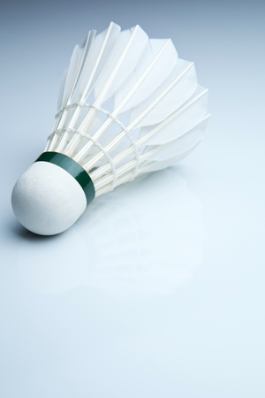 Badminton shuttlecock on white photo