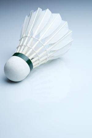 Badminton shuttlecock on white photo