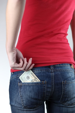Closeup of woman's bottom with banknotes in the pocket