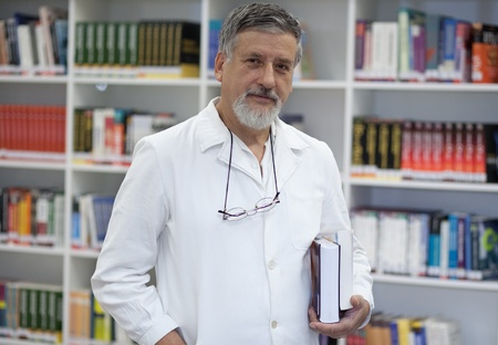Renowned scientistdoctor in a library of research centerhospital looking confident photo