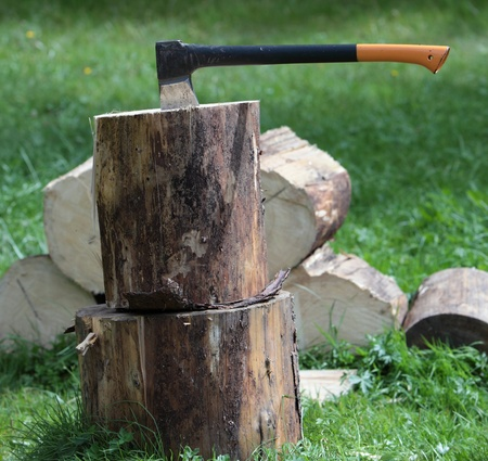 Chopping wood - ax in a log outdoors Stock Photo - 9800191