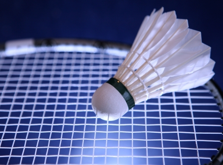 shuttlecock: Badminton racket and shuttlecock on its strings (color toned image)