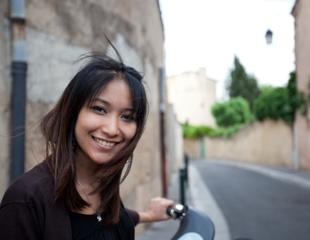 Portrait of a very attractive young asian woman with a lovely smile looking at the camera Stock Photo - 9902571