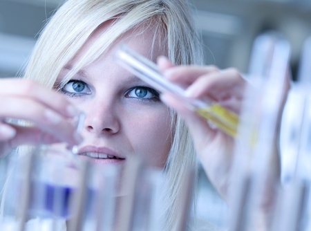 Closeup of a female researcher carrying out experiments in a lab Stock Photo - 9792430