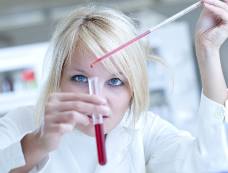 Closeup of a female researcher carrying out experiments in a lab Stock Photo - 9793559