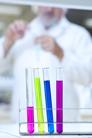 scientific research concept - in the lab (shallow depth of field; focus on the test tubes; color toned image) photo
