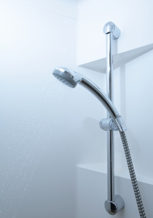 shampooing: Shower with running water (color toned image) Stock Photo
