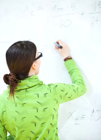 young female college student in front of a whiteboard during a math class Stock Photo - 9903475