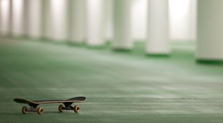 skateboard in an underground parking - perfect place for a ride (color toned image) Stock Photo - 9813427