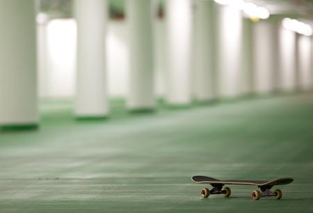 skateboarding: skateboard in an underground parking - perfect place for a ride Stock Photo