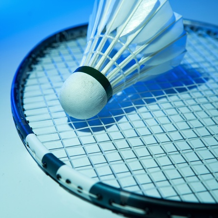 badminton: Badminton racket and shuttlecock on its strings