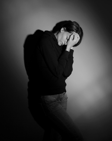 Young woman suffering from severe depression photo