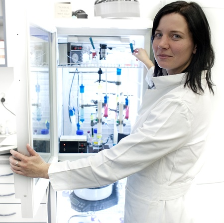 Portrait of a female researcher carrying out research experiments in a lab - researcher taking a substance from a freezer photo