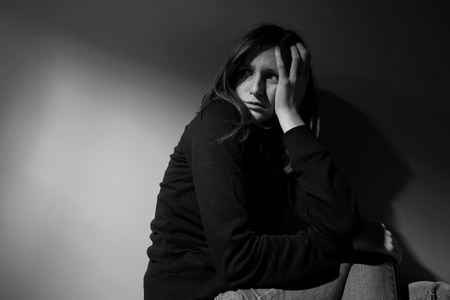 Young woman suffering from severe depression Stock Photo - 9792692