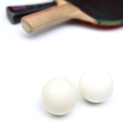 Two table tennis rackets and balls on white background photo