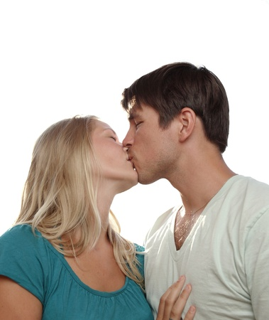 Young lovely couple kissing lovingly - isolated on white photo