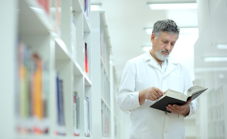 Renowned scientistdoctor in a library of research centerhospital - browsing a book photo