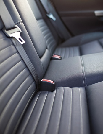 Modern car interior - rear seats with the seat belts photo